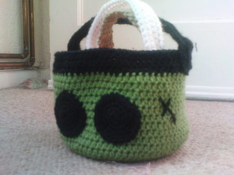 Cute, but also practical! .  Stitch a knit or crochet basket in under 180 minutes by crocheting with acrylic yarn. Inspired by halloween and monsters. Creation posted by Julie G. Difficulty: Easy. Cost: Cheap.