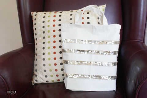 An easy 3 supplies and 3 step DIY .  Free tutorial with pictures on how to make an embellished tote in under 10 minutes by constructing with hot glue gun, tote bag, and sequin trim. Inspired by clothes & accessories. How To posted by Anna L. Difficulty: Easy. Cost: Cheap. Steps: 3