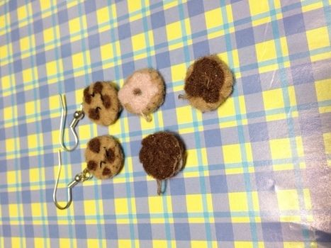 Small felt cookie on ear .  Make a pair of fabric earrings in under 40 minutes by sewing with felt, earring hooks, and earring studs. Creation posted by Rainyriver. Difficulty: Simple. Cost: Cheap.