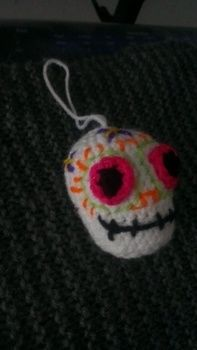 A sugar skull to keep all year long!! .  Free tutorial with pictures on how to make a food plushie in under 60 minutes by crocheting with stuffing and wool. Inspired by halloween, domo kun, and domo kun. How To posted by Lane L. Difficulty: Easy. Cost: Absolutley free. Steps: 2