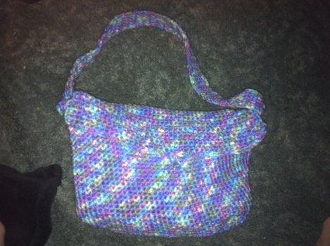 First purse and I think I did pretty good.  .  Make a knit or crochet tote in under 180 minutes by crocheting with yarn, crochet hook, and buttons. Inspired by for girls and clothes & accessories. Creation posted by Staci  Fowler. Difficulty: Simple. Cost: Cheap.