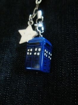 A mini Tardis ready to travel through space and time!  .  Sculpt a clay character charm in under 60 minutes by jewelrymaking with polymer clay. Creation posted by Lindsey  N. Difficulty: Easy. Cost: Absolutley free.