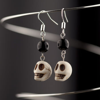 Simple yet cute earrings :) .  Sculpt a set of clay character earrings in under 10 minutes by jewelrymaking with beads, earring hooks, and eye pins. Inspired by halloween, gothic, and steampunk. Creation posted by Natalie Louise. Difficulty: Easy. Cost: Cheap.