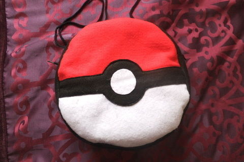 Gotta catch 'em all! .  Free tutorial with pictures on how to make a novetly bag in under 180 minutes by sewing with felt, sewing machine, and zipper. Inspired by pokemon. How To posted by JossieAyame. Difficulty: Simple. Cost: Cheap. Steps: 8