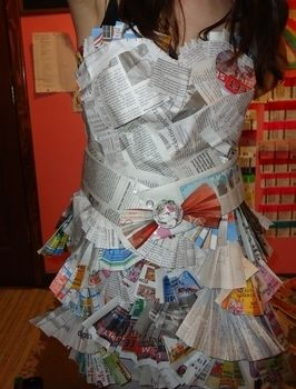 Newspaper dress I made for Snow Week .  Recycle a paper dress in under 180 minutes by decorating, embellishing, and dressmaking with newspaper and scotch tape. Inspired by costumes & cosplay, people, and hearts. Creation posted by Rachel's Craft Channel. Difficulty: Simple. Cost: No cost.