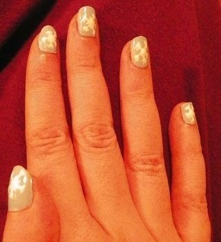 Wintery nails .  Paint seasonal nail art in under 10 minutes by nail painting with paint and clear nail polish. Inspired by christmas. Creation posted by Laura. Difficulty: Easy. Cost: Absolutley free.