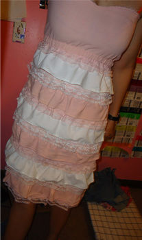 A pink and white ruffled skirt and shirt, that were originally a dress I had made .  Recycle a dress into a skirt in under 180 minutes by sewing with fabric, ribbon, and elastic. Inspired by vintage & retro, people, and flowers. Creation posted by Rachel's Craft Channel. Difficulty: Simple. Cost: No cost.