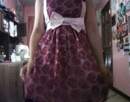 A formal occasion dress .  Sew a lace dress in under 120 minutes by sewing and dressmaking with fabric, zipper, and pattern paper. Inspired by vintage & retro, people, and flowers. Creation posted by Rachel's Craft Channel. Difficulty: 3/5. Cost: No cost.