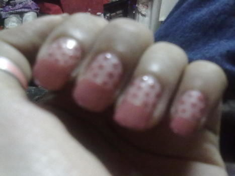 French mani with polka dots .  Paint patterned nail art in under 60 minutes by nail painting and nail painting with clear nail polish. Inspired by polka dot. Creation posted by Sonia M. Difficulty: Easy. Cost: No cost.