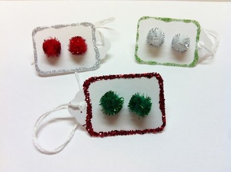 Deck The Halls & Your Ears! .  Free tutorial with pictures on how to make a pair of fabric earrings in under 10 minutes by jewelrymaking with scrapbook paper, earring  backs, and tags. Inspired by christmas. How To posted by Pam. Difficulty: Easy. Cost: Cheap. Steps: 4