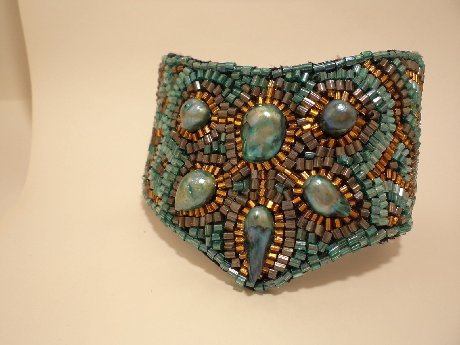 Turquoise bead embroidered cuff bracelet · a beaded