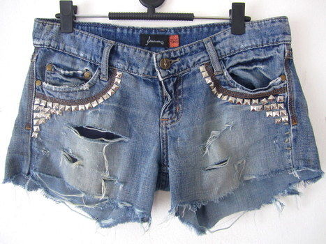 Revamp your pair of old jeans! Add studs, rivets and fray it to make it current! .  Free tutorial with pictures on how to make shorts in under 40 minutes by decorating, studding, and studding with scissors, pencil, and ruler. How To posted by Cinnamon S. Difficulty: Simple. Cost: Cheap. Steps: 11