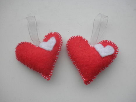 Easy way to hang some love on the tree, on some keys or around the house as decorations! .  Make a shape plushie in under 20 minutes by needleworking, sewing, and felting with felt, ribbon, and needle and thread. Inspired by crafts, christmas, and hearts. Creation posted by English Ginger. Difficulty: Easy. Cost: Absolutley free.