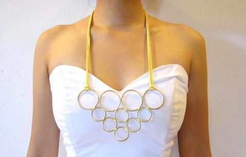 Make a funky bib necklace using multi-sized rings! .  Free tutorial with pictures on how to make a wire hoop necklace in under 30 minutes by jewelrymaking with suede cord, gold wire, and circle rings. How To posted by Cinnamon S. Difficulty: 3/5. Cost: Cheap. Steps: 8
