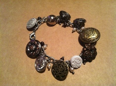 Awesome button bracelet .  Free tutorial with pictures on how to make a button bracelet in under 30 minutes by beading, jewelrymaking, and chainmailing with beads and  buttons. Inspired by clothes & accessories. How To posted by Sanne E. Difficulty: Simple. Cost: Cheap. Steps: 2