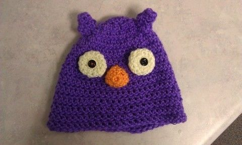 A cute, simple Owl Hat!! .  Make an animal hat in under 130 minutes by sewing and crocheting with yarn, yarn, and yarn. Inspired by birds, owls, and clothes & accessories. Creation posted by Yarn Zoo. Difficulty: Easy. Cost: Cheap.