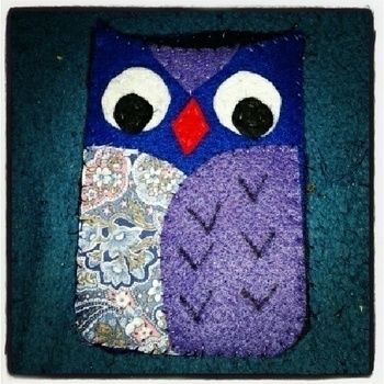 Quick and easy way to keep your phone or mp3 player snug! .  Sew a fabric animal pouch in under 60 minutes by sewing and felting with felt, cotton thread, and lining fabric. Inspired by owls and gadgets. Creation posted by Tess. Difficulty: Easy. Cost: Cheap.