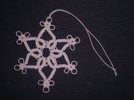 Needle Tatted Lace Ornament .  Make a snowflake in under 180 minutes by needleworking with crochet thread and tatting needle. Inspired by christmas, steampunk, and victorian. Creation posted by Jessica B. Difficulty: 4/5. Cost: Cheap.