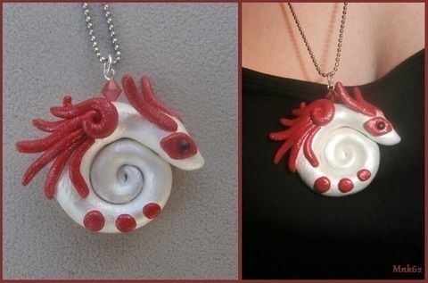 Cute dragon! .  Mold a clay pendant in under 180 minutes by jewelrymaking and potting with polymer clay. Inspired by dragon, costumes & cosplay, and monsters. Creation posted by Monkiki62. Difficulty: 3/5. Cost: 3/5.