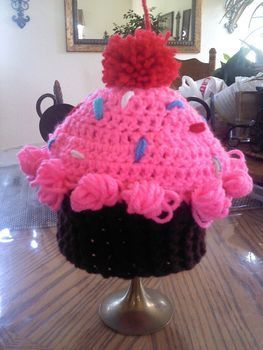 Cupcake beanie  .  Make a cake hat in under 120 minutes by crocheting with yarn and crochet hook. Inspired by clothes & accessories. Creation posted by wendy t. Difficulty: Simple. Cost: Cheap.