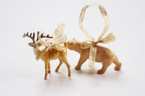 Transform plastic animals into fun tree ornaments.  .  Free tutorial with pictures on how to make a Christmas decoration in under 60 minutes by spraypainting with ribbon, needle, and paint. Inspired by christmas. How To posted by kittenhood. Difficulty: Simple. Cost: Cheap. Steps: 4