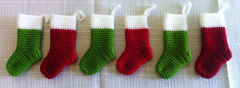 Crocheted Little Christmas Socks .  Make a Christmas stocking in under 30 minutes by yarncrafting and crocheting with yarn and crochet hook. Inspired by crafts and christmas. Creation posted by Tales of Twisted Fibers. Difficulty: Easy. Cost: Absolutley free.