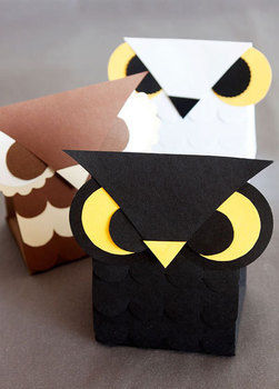 These little owlies are the perfect container for everything from party favors to Halloween treats. .  Free tutorial with pictures on how to make a paper box in under 60 minutes by papercrafting with ruler, cardstock, and printer. Inspired by owls. How To posted by Kristen M. Difficulty: Easy. Cost: Absolutley free. Steps: 6