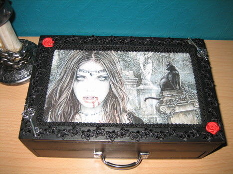 How to gothicize a plain wooden jewelry box .  Free tutorial with pictures on how to make a box in under 180 minutes by creating and decorating with acrylic paint, hot glue gun, and lace. Inspired by gothic and clothes & accessories. How To posted by Sofie Vandersmissen. Difficulty: Easy. Cost: Cheap. Steps: 8