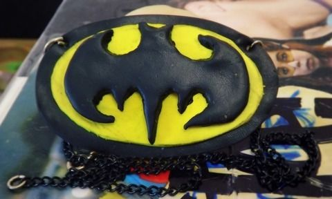 Nanananana Batman! Batman! .  Mold a clay necklace in under 40 minutes by applying makeup, making beauty products, jewelrymaking, metalworking, and molding with polymer clay and string. Inspired by batman, costumes & cosplay, and people. Creation posted by Andri-u-.  in the Jewelry section Difficulty: 4/5. Cost: Cheap.