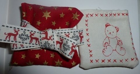 Quirky alternative to tiresome gift wrapping .  Make a pouch, purse or wallet in under 30 minutes by needleworking with ribbon, needle and thread, and fabric scraps. Inspired by christmas. Creation posted by Scarlett Hews. Difficulty: Easy. Cost: Absolutley free.