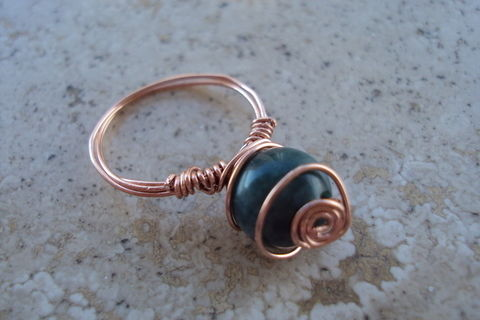 Smaller companion for the other ring :) .  Make a wire wrapped ring in under 20 minutes by wireworking with beads, wire, and pliers. Creation posted by Juliet J. Difficulty: Easy. Cost: No cost.