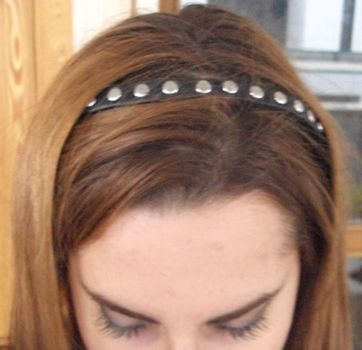 Let's put some studs on it! .  Free tutorial with pictures on how to make an embellished headband in under 40 minutes by studding with hot glue gun, nail polish, and hair band. Inspired by gothic, punk, and rock band. How To posted by Juliet J. Difficulty: Simple. Cost: Absolutley free. Steps: 5
