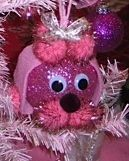 Super cute and super easy to make pink poodle ornament! .  Make a Christmas decoration in under 20 minutes by decorating with wiggly eyes, ornament, and pom pom. Inspired by crafts and christmas. Creation posted by Joanne C. Difficulty: Easy. Cost: Cheap.
