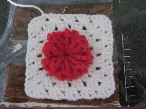 Once you have completed your 17 flowers (shown in flower tutorial) its time to  turn them into a granny square .  Free tutorial with pictures on how to make a knit or crochet tote in 31 steps by crocheting with yarn and crochet hook. Inspired by christmas, vintage & retro, and flowers. How To posted by joanne.mccreath. Difficulty: Easy. Cost: Cheap.
