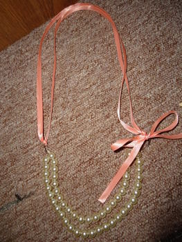 A creation of mine based off another project .  Make a pearl necklace in under 30 minutes using ribbon, jump rings, and string. Inspired by christmas, costumes & cosplay, and vintage & retro. Creation posted by Rachel's Craft Channel. Difficulty: Easy. Cost: Cheap.
