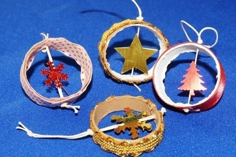 Cute little things to place on your Christmas tree! Handmade and recycled, from scraps and more! .  Free tutorial with pictures on how to make a Christmas decoration in under 20 minutes by beading, embellishing, needleworking, and papercrafting with thread, beads, and ribbon. Inspired by crafts, christmas, and kawaii. How To posted by Gaby R. Difficulty: Easy. Cost: No cost. Steps: 7