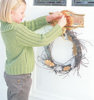 Make this decorative door wreath from natural twigs and decorate with dried leaves painted silver and gold.  .  Free tutorial with pictures on how to make a branch & twig wreath in under 30 minutes by decorating with scissors, ribbon, and glue. Inspired by christmas. How To posted by Ryland Peters & Small. Difficulty: Simple. Cost: Cheap. Steps: 4