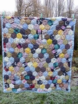 Recycled Fabric Quilt .  Sew a hexagon patchwork in under 1 minutes using thread, batting, and fabrics. Creation posted by PixieFey. Difficulty: Easy. Cost: Absolutley free.