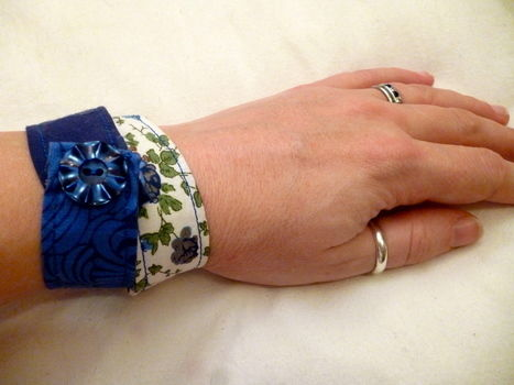 Make a pretty fabric cuff - perfect easy DIY gift idea for a friend (plus use up your fabric scraps!) .  Free tutorial with pictures on how to make a fabric cuff in under 75 minutes by sewing with buttons, iron, and snap button(s). Inspired by for girlfriends, christmas, and clothes & accessories. How To posted by Suki F. Difficulty: Simple. Cost: Absolutley free. Steps: 10