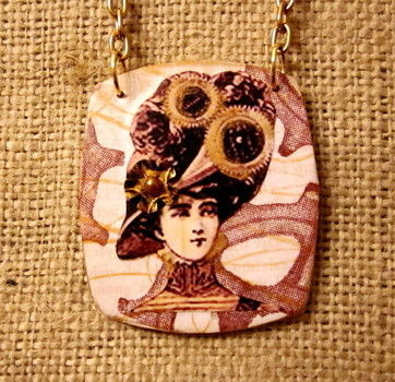 Altered children's game piece Wearable Art .  Make a paper necklace in under 60 minutes by jewelrymaking, papercrafting, collage, decoupaging, and decoupaging with paper and decoupage glue. Creation posted by Wendy W. Difficulty: Simple. Cost: Cheap.