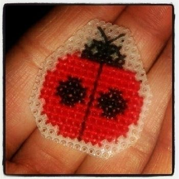 :) .  Stitch a stitched brooch in under 120 minutes by cross stitching and cross stitching with embroidery thread, brooch back, and plastic canvas. Inspired by ladybirds. Creation posted by Tess. Difficulty: Easy. Cost: Cheap.