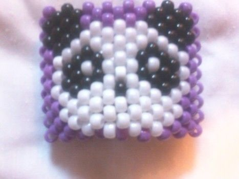 My first kandi cuff .  Make a beaded cuff in under 105 minutes by jewelrymaking, weaving, and not sewing with scissors, string, and pony beads. Inspired by monsters and clothes & accessories. Creation posted by Lauren W. Difficulty: Simple. Cost: Cheap.