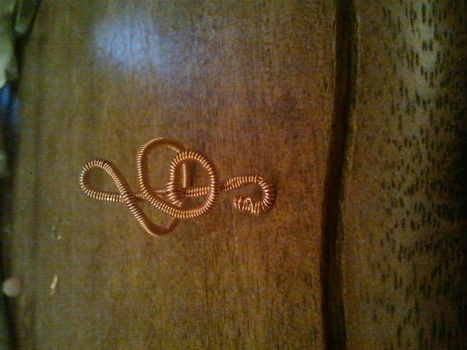 A Treble Clef Ring for a friend. .  Make a trebel clef wire ring in under 20 minutes using jewelry wire. Inspired by christmas. Creation posted by lolly p. Difficulty: Simple. Cost: Absolutley free.