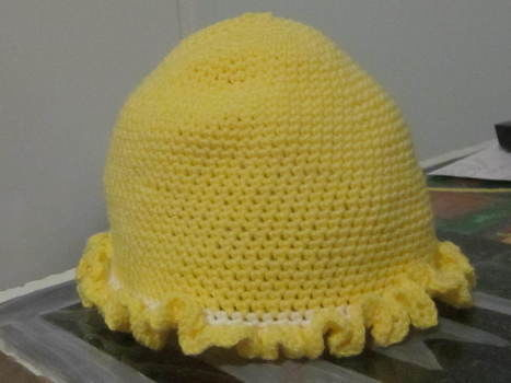 SWEET LITTLE HAT WITH RUFFLE TRIM can use jaquard (varigated) yarn for a different effect .  Free tutorial with pictures on how to make a baby hat in 12 steps by crocheting with crochet hook and yarn. Inspired by vintage & retro, people, and clothes & accessories. How To posted by joanne.mccreath. Difficulty: 3/5. Cost: Absolutley free.