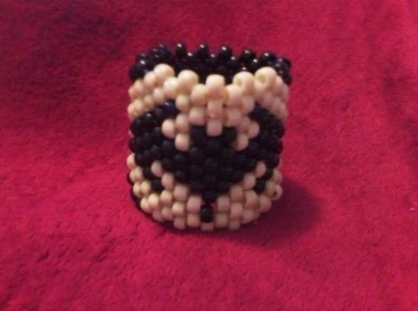 BATMAN PLUR .  Make a beaded cuff in under 120 minutes by beading, jewelrymaking, and weaving with string and pony beads. Inspired by halloween, batman, and gothic. Creation posted by Lauren W. Difficulty: Simple. Cost: Cheap.