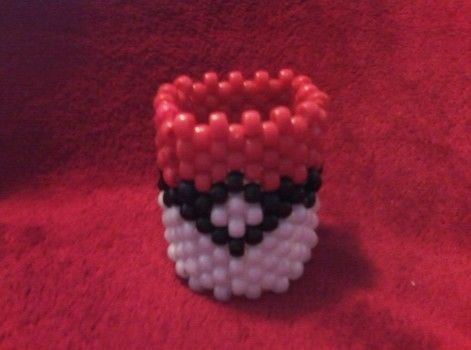 POKEMAN PLUR .  Make a beaded cuff in under 120 minutes by beading, jewelrymaking, weaving, and not sewing with string and pony beads. Inspired by halloween, monsters, and clothes & accessories. Creation posted by Lauren W. Difficulty: Simple. Cost: Cheap.