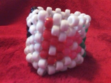 BOTDF PLUR .  Make a beaded cuff in under 120 minutes by beading, weaving, and not sewing with string and pony beads. Inspired by halloween, gothic, and monsters. Creation posted by Lauren W. Difficulty: Simple. Cost: Cheap.