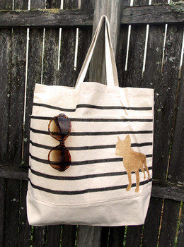 Customize any reusable bag with stripes and a golden animal silhouette (or initial). .  Free tutorial with pictures on how to paint a painted tote in 11 steps by drawing and embellishing with pencil, fabric paint, and ruler. Inspired by christmas and clothes & accessories. How To posted by Sara R. Difficulty: Easy. Cost: Cheap.
