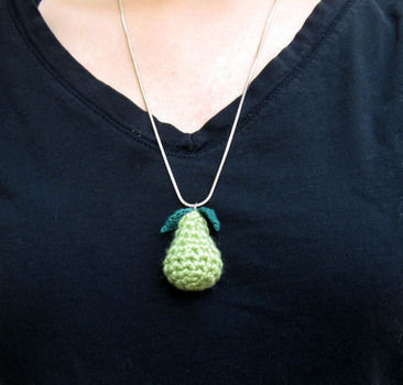 The cutest dang pear necklace you ever did see. .  Free tutorial with pictures on how to knit or crochet a knit or crochet necklace in under 30 minutes by jewelrymaking and crocheting with scissors, crochet hook, and crochet hook. Inspired by pears. How To posted by Heidi (Speckless). Difficulty: 3/5. Cost: Absolutley free. Steps: 5