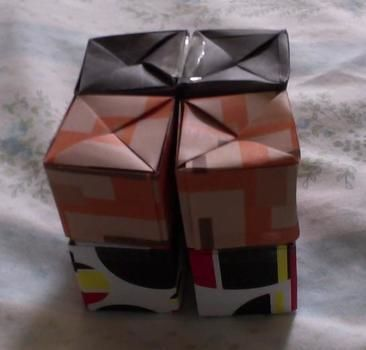 It transforms!  .  Fold an origami shape in under 60 minutes by papercrafting, paper folding, paper folding, and paper folding with tape and origami paper. Inspired by gifts, toys, and cubes. Creation posted by Conn. Difficulty: Simple. Cost: No cost.
